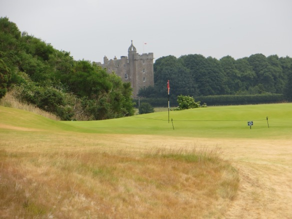 The green on the 4th seems dwarfed by a castle almost a mile away.