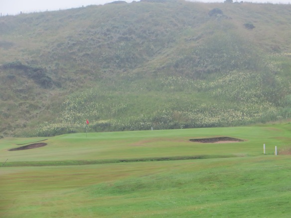 Resplendent view from the 10th tee a the dune wall that shadows the holes coming in.