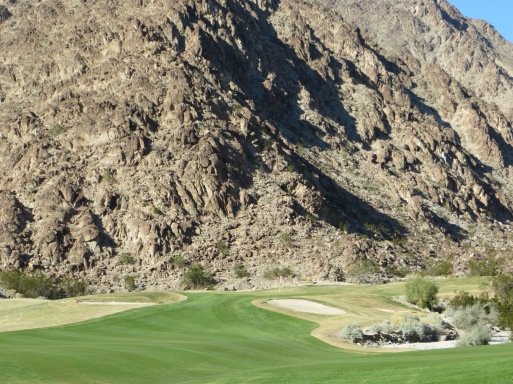 Approach to 14 is set against the mountain backdrop